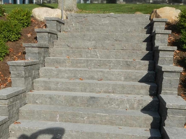 twelve stone stairs leading to a yard