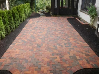 brick walkway on side of house