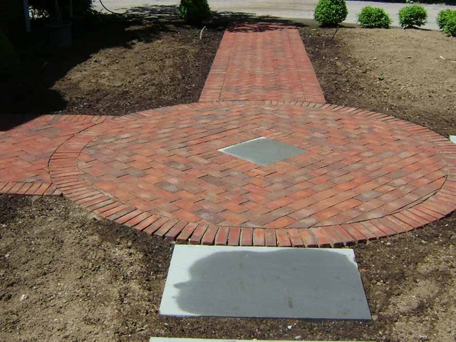 brick pavers arranged in a circle in a yard