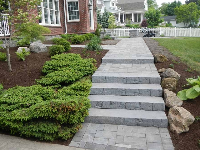 stone steps and walkway leading to front of house