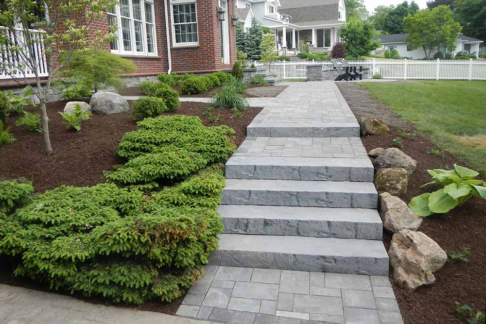 stone walkway and stairs in front of house