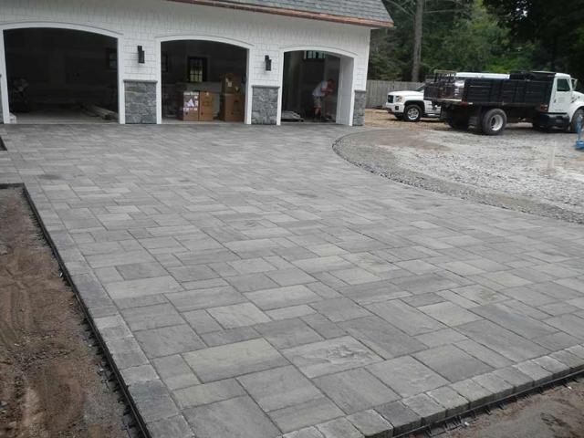 stone driveway with three car garage