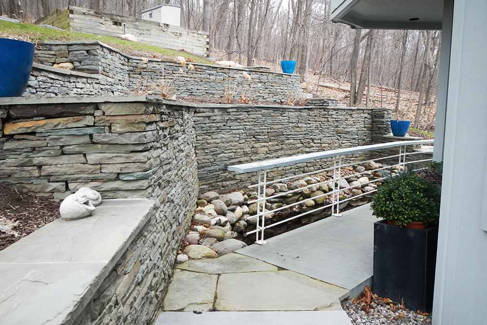 stone wall with walkway and plants