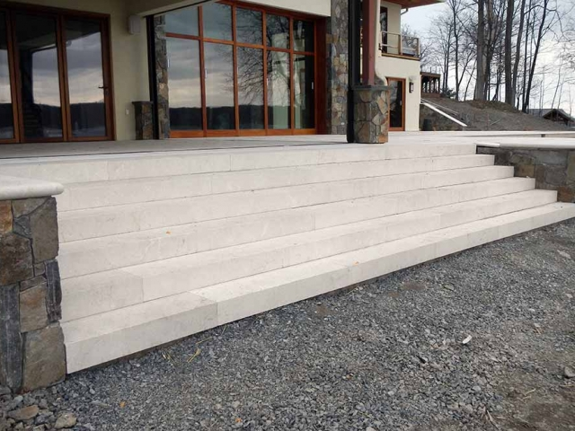 cement stairs on front of house