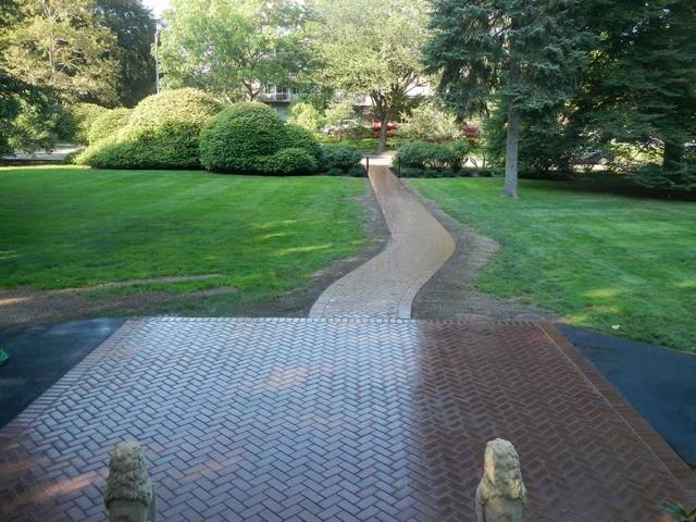 brick patio with brick walkway in yard