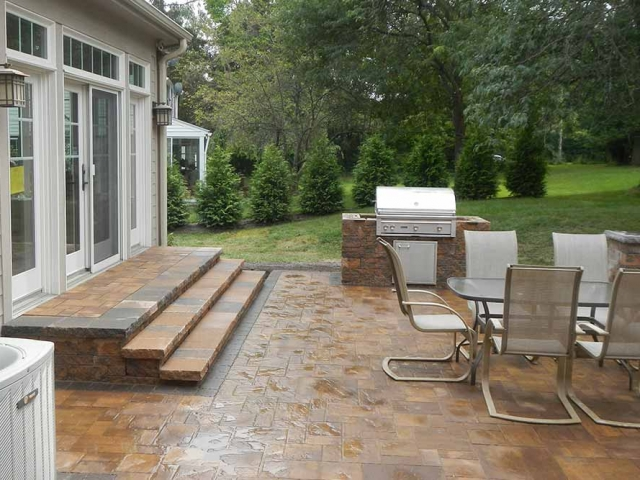 back patio with stone steps and outdoor furniture