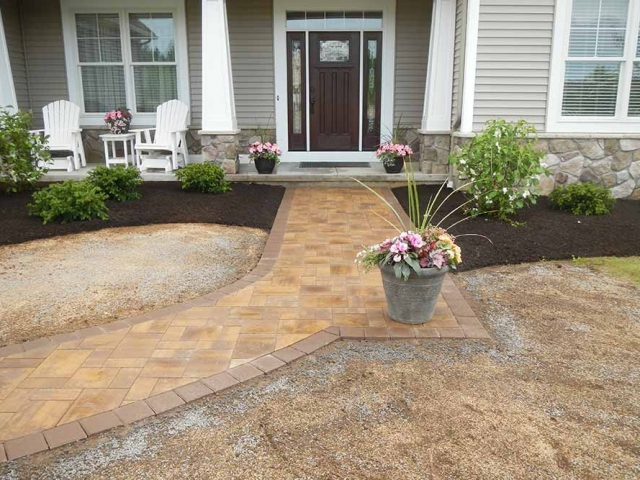 front stone walkway with potted flowers