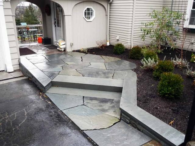 stone walkway leading to backyard