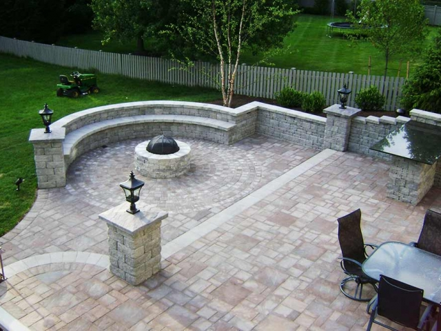 backyard with stone patio and outdoor furniture